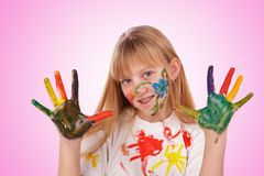 Beautiful little girl with hands painted Royalty Free Stock Photography