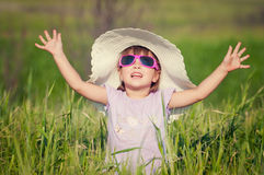 A beautiful little girl with a hat in a grain fiel Royalty Free Stock Images