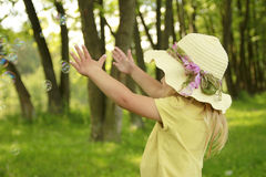 Beautiful little girl in a hat on the nature Royalty Free Stock Photography