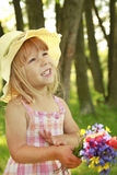 Beautiful little girl in a hat Stock Image