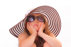 Beautiful little girl in a hat and with sunglasses Royalty Free Stock Photography