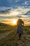 Beautiful little girl with hat at the sunset Royalty Free Stock Image