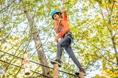 Beautiful little girl having fun in adventure Park, Montenegro.  Royalty Free Stock Image