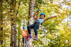 Beautiful little girl having fun in adventure Park, Montenegro.  Royalty Free Stock Photography