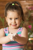 Beautiful little girl having fun cooking Royalty Free Stock Photo
