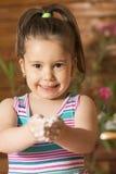 Beautiful little girl having fun cooking Royalty Free Stock Photo