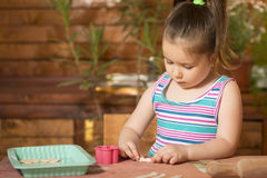 Beautiful little girl having fun cooking Royalty Free Stock Photos