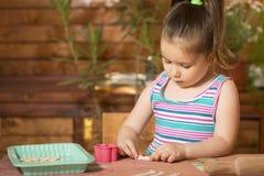 Beautiful little girl having fun cooking Royalty Free Stock Photos