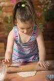 Beautiful little girl having fun cooking Stock Photo