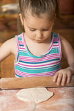 Beautiful little girl having fun cooking Stock Photography