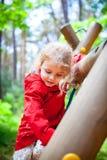 Girl playground. Beautiful little girl having fun at the playground stock photos