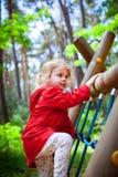 Girl playground. Beautiful little girl having fun at the playground stock image