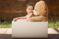 Beautiful little girl having fun playing outdoors Stock Photo