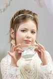A beautiful little girl having a tea party Stock Photos