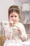 A beautiful little girl having a tea party Stock Images