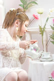 A beautiful little girl having a tea party Royalty Free Stock Images