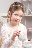 A beautiful little girl having a tea party Royalty Free Stock Photos
