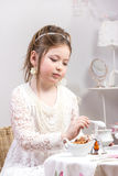 A beautiful little girl having a tea party Stock Image