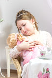 Beautiful little girl having a tea party Royalty Free Stock Photography
