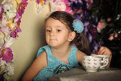 Beautiful little girl having a tea party Stock Photo