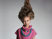 Beautiful little girl with healthy hair.pretty little lady. In dress and accessories stock image
