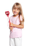 Beautiful little girl with heart. Beautiful little in love girl with heart isolated on white background Royalty Free Stock Image