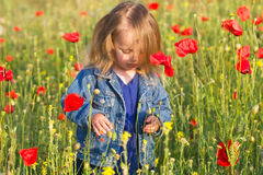 Beautiful little girl with her hair in a denim jacket Stock Images