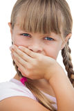 Beautiful little girl with her hand on her mouth Royalty Free Stock Images