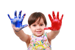 Beautiful little girl with her hands full of paint Royalty Free Stock Images