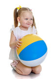 Beautiful little girl on her knees with the ball Royalty Free Stock Photo