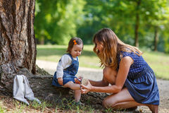 Beautiful little girl and her young mother having fun together Stock Images