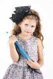 Beautiful little girl holding big crayon Royalty Free Stock Images