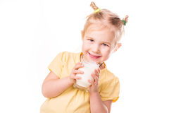 Beautiful little girl holding a cup of milk. Royalty Free Stock Image