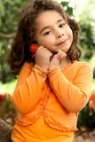 Beautiful little girl holding a flower picked from the garden Royalty Free Stock Photos