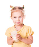 Beautiful little girl holding a glass of fresh milk. Royalty Free Stock Photography