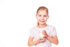 Beautiful little girl holding a glass of fresh milk. Stock Image