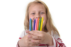 Beautiful little girl holding multicolor crayons set in art school children education concept Stock Photography