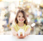 Beautiful little girl holding paper house cutout Stock Photography