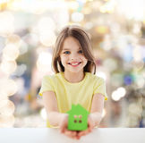Beautiful little girl holding paper house cutout Royalty Free Stock Photography
