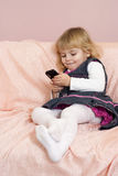 Beautiful little girl holding a phone Royalty Free Stock Photo