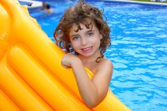 Beautiful little girl holding pool float smiling Stock Images