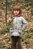 Beautiful little girl holding snowdrops stock photos