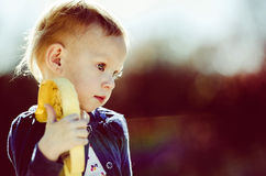 Beautiful Little Girl Holding Toy Stock Photo
