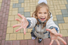 Beautiful little girl holds hands up Stock Photos