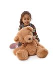 Beautiful little girl with huge plush bear Stock Image