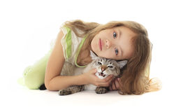 Beautiful little girl hugging cat. Royalty Free Stock Photography