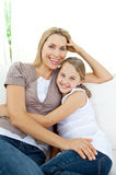 Beautiful little girl hugging her smiling mother Royalty Free Stock Photos