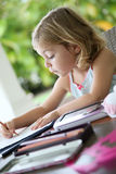 Beautiful little girl imagining and drawing. Portrait of little girl making drawings Stock Image