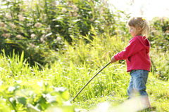Free Beautiful Little Girl In Nature Playing With A Stick Royalty Free Stock Photography - 37852717