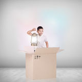 Beautiful little girl inside a cardboard box Stock Photography